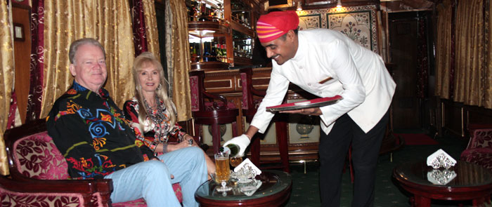 liquor serve by bartender in luxury train comfortable bar cum lounge